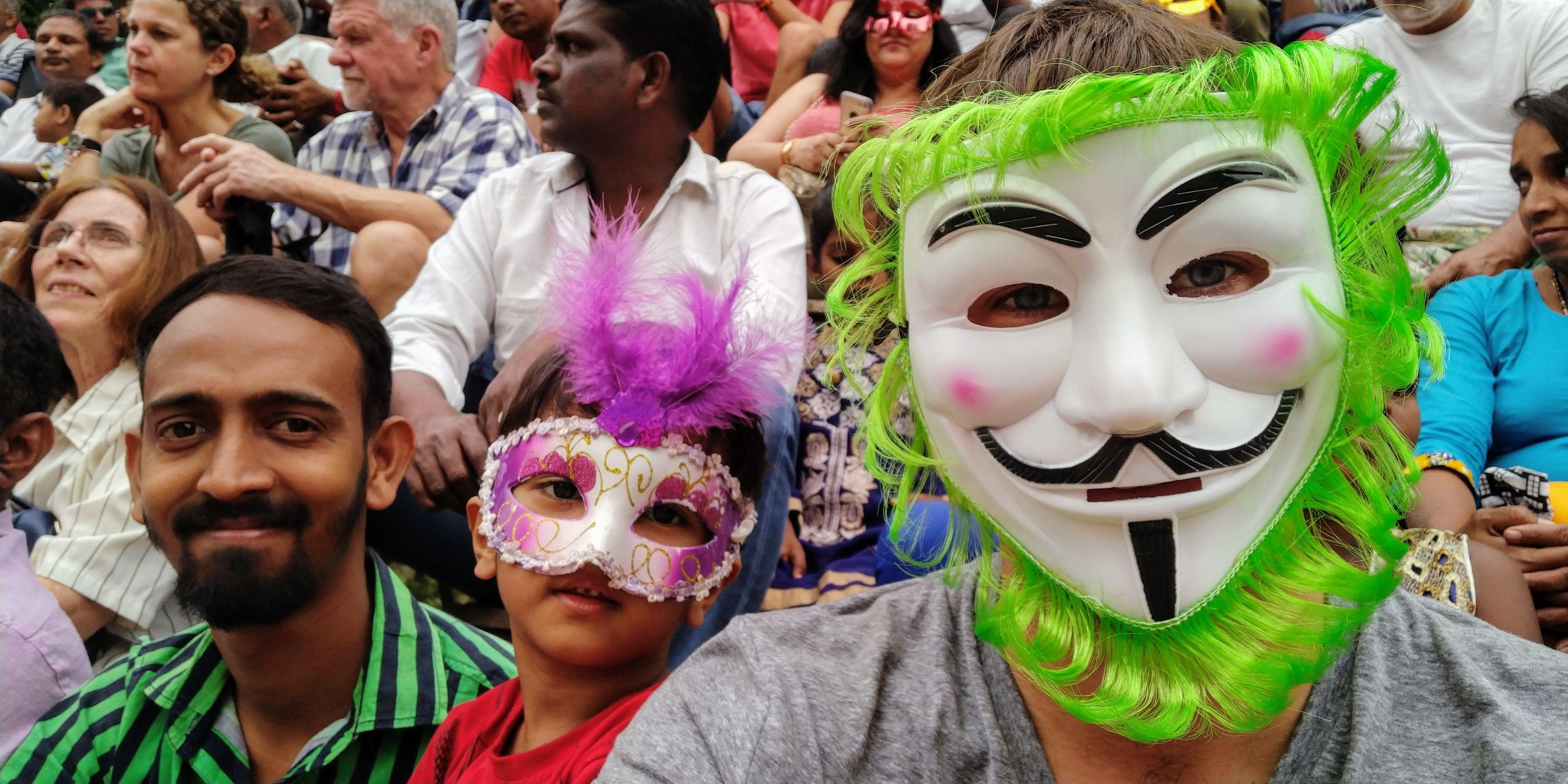 Celebrating the Goa Carnival in Panji India wearing a Guy Fawkes mask